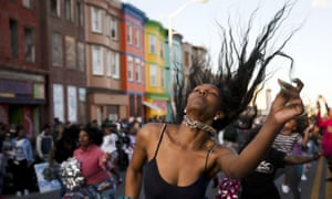 Protesters dance on 28 April in Baltimore