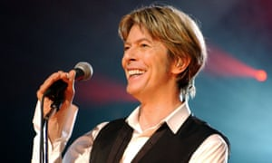 """(FILES) This file photo taken on July 1, 2002 shows British singer David Bowie performing in Paris during his only Paris gig. British rock music legend David Bowie has died after a long battle with cancer, his official Twitter and Facebook accounts said on January 11, 2016. Bowie died on Januray 10 surrounded by family according to his social media accounts. The iconic musician had turned 69 only on January 8, which coincided with the release of """"Blackstar"""", his 25th studio album. / AFP / BERTRAND GUAYBERTRAND GUAY/AFP/Getty Images"""