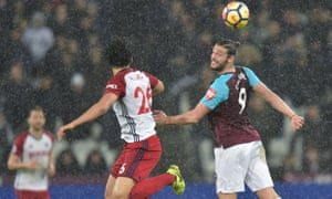 Andy Carroll (right) in the air is a fearsome sight but his injuries and teams' worse crossing makes him less effective than he once was.