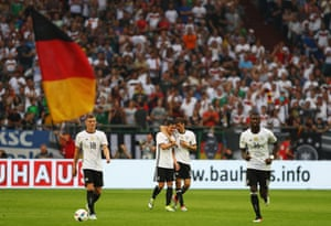 Thomas Muller of Germany celebrates scoring his teams second goal of the game with Mesut Ozil during the international friendly match between Germany and Hungary at Veltins-Arena on June 4, 2016 in Gelsenkirchen, Germany