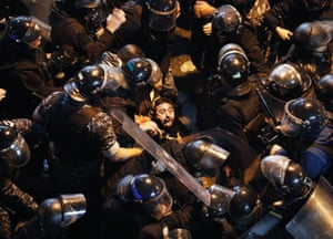 Beirut, LebanonRiot police arrest an anti-government protester who was outside a police headquarters demanding the release of those taken into custody.