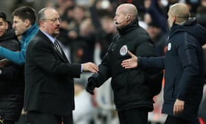 Newcastle United manager Rafael Benitez shakes hands with Manchester City manager Pep Guardiola.