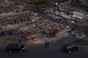 FILE PHOTO: Security officials survey neighborhood left devastated by the Almeda fire in Phoenix, OregonFILE PHOTO: Security officials survey the Bear Lakes Estates neighborhood which was left devastated by the Almeda fire in Phoenix, Oregon, U.S., September 9, 2020. Image taken with a drone. REUTERS/Adrees Latif/File Photo