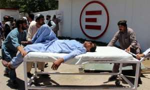 A man is transported to hospital after the car bomb attack in Lashkar Gah, Afghanistan