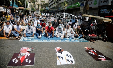 Palestinians protest with cutouts depicting Donald Trump, Mohammed bin Zayed Al Nahyan and Benjamin Netanyahu, in the West Bank, 14 August 2020.