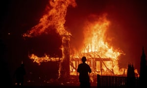 A home burns as the Camp Fire rages through Paradise, California on 8 November 2018.