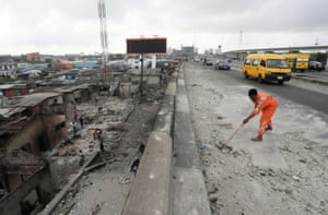 Lagos, Nigeria, A worker cleans a street, as a round-the-clock curfew eases, imposed in response to protests against alleged police brutality