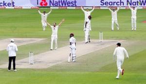 England's Chris Woakes celebrates taking the wicket of West Indies' Jason Holder lbw