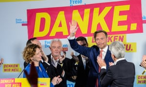 Christian Lindner, lead candidate of the Free Democratic Party (FDP), waves to supporters after initial results give the party a 4th place finish with 10,5% of the vote following German federal elections in Berlin.
