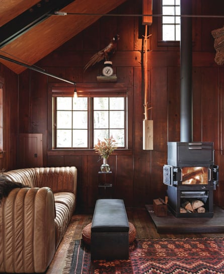 An attic was removed to give the cabin its 17ft-high ceiling. The stove and sofa are both from the 1970s.
