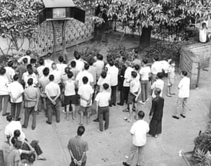 Locals gather around a television in a park in Hong Kong broadcasting the Apollo 11 moon landing