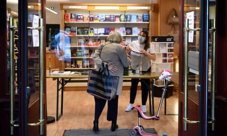 'Lire, c'est vivre' … a woman collects an order at a bookshop in Neuilly-sure-Seine, France, in April.