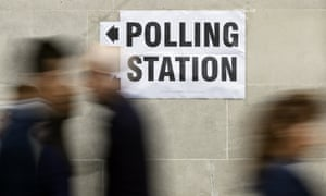 People walk to a polling station in London for the 2015 general election.