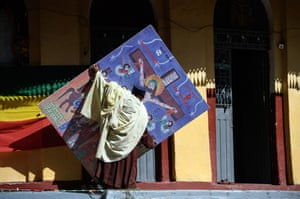 A priest carries a picture of Christ on the cross as final preparations are made as Timkat celebrations get under way