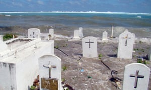 A cemetery on the shoreline in Majuro Atoll, Marshall Islands, flooded from high tides and ocean surges