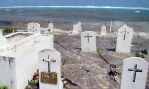 A photo taken in December 2008 shows a cemetery on the shoreline in Majuro Atoll being flooded from high tides and ocean surges in the low-lying Marshall Islands.