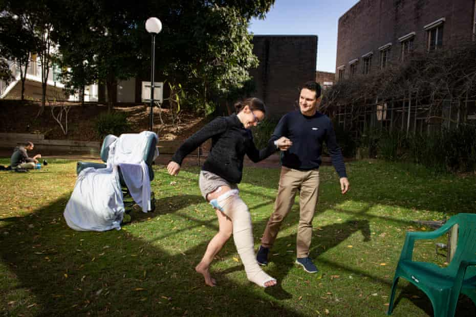 Chantelle Doyle and Mark Rapley get some sun in the patient garden at John Hunter Hospital, Newcastle.