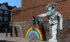 Street artist Chris Shea works on his 100th Rainbow Boy artwork at the Swan pub in West Wickham, south-east London.