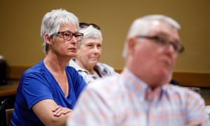 Sandy Sothman, left, and Ardyth Gillespie listen as Iowa Democratic congressional candidate Cindy Axne talks to primary voters on 16 May in Cass county where where Trump won by 39%.