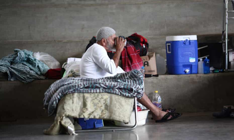 A man who lost his home during Hurricane Maria in September sits on a cot at a school turned shelter in Canovanas.