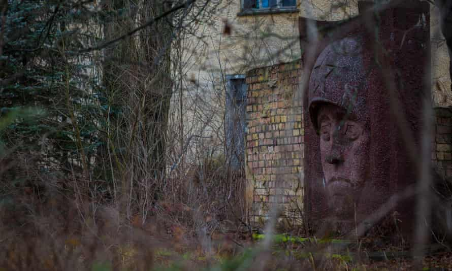 A monument to a Soviet soldier stands watch through the trees at Wünsdorf.
