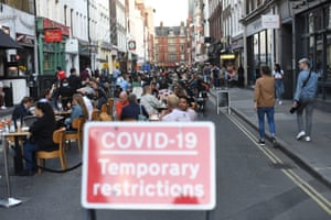 People socialising in Soho, central London, after the lifting of further coronavirus lockdown restrictions in England on 11 July, 2020. Revellers are urged to remember the importance of social distancing as pubs gear up for the second weekend of trade since the lifting of lockdown measures.