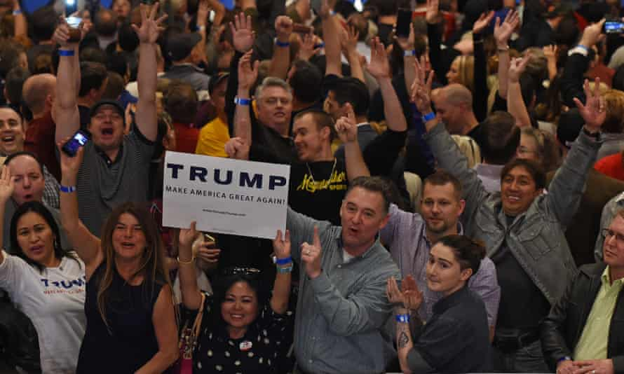 Donald Trump supporters cheer while waiting for him to speak at his victory rally in Las Vegas.