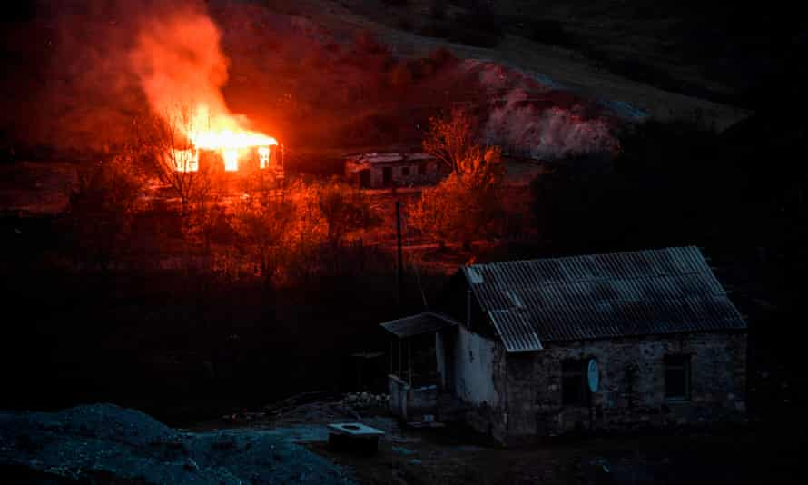 Villagers outside Nagorno-Karabakh set their homes on fire before fleeing to Armenia ahead of a deadline that will see some disputed territory handed over to Azerbaijan as part of a peace agreement