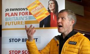 The Scotttish Lib Dem leader Willie Rennie throwing a copy of the Scottish Lib Dem manifesto at Murrayfield Curling Rink, Edinburgh.