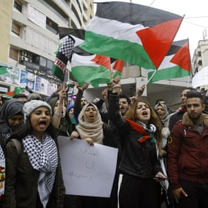 Lebanese and Palestinian students chant slogans and hold Palestinian flags as they take part in a protest in the southern port city of Sidon.
