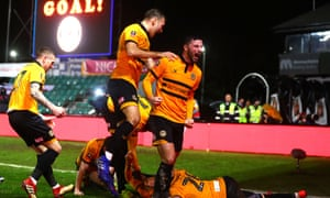 Newport's players celebrate the goal from Robbie Willmott, early in the second half, that set them en route to another famous victory.