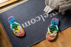Flipflops in Pride colours on welcome mat