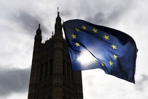 An EU flag is flown in front of parliament amid rival pro- and anti-Brexit protests in London.
