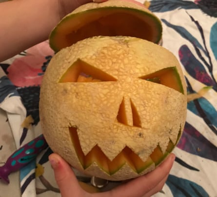 A rockmelon carved like a jack-o-lantern bears more than a passing resemblance to George Costanza