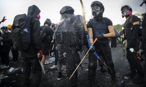 A Hong Kong student prepares a bow and arrow during a protest on Wednesday.