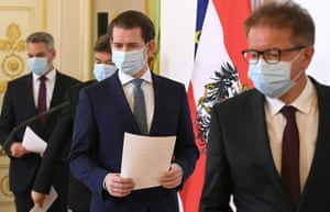 Austrian chancellor Sebastian Kurz, centre, and ministers arrive for a news conference in Vienna