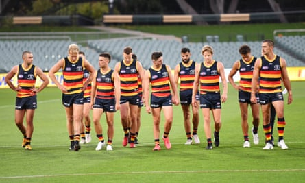 Crows players walk from the field
