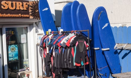 Surfboards and wet suits outside surf shop in Perranporth