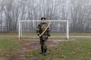 A cadet holds a model of a sword in front of a goalpost as he trains at the stadium of the General Yermolov Cadet School in Stavropo