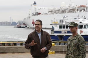 Andrew Cuomo, left, gestures during a brief news conference as he stands beside a Rear Adm. John B. Mustin as the USNS Comfort, a naval hospital ship with a 1,000 bed-capacity, pulls into Pier 90 Monday, March 30, 2020, in New York.