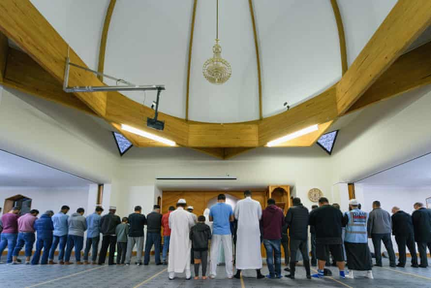 Worshippers are seen praying on freshly laid underlay at Al Noor mosque in Christchurch on Thursday.