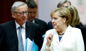 Jean-Claude Juncker and Angela Merkel discuss matters on day two of the EU leaders' summit.