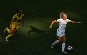 Alex Greenwood of England runs with the ball under pressure from Julia Zigiotti of Sweden.
