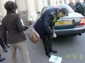 Peter Mandelson is covered in green custard thrown by Heathrow protester Leila Deen in 2009