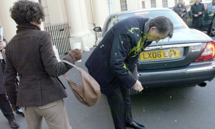 Peter Mandelson is covered in green custard thrown by Heathrow protester Leila Deen in London in 2009.