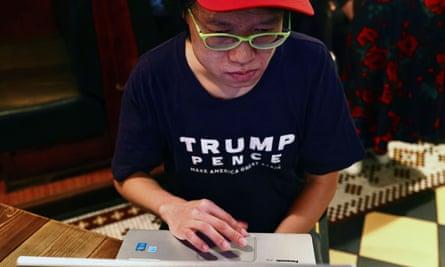 A person wears a Trump shirt at a bar in Taipei, Taiwan on 4 November.