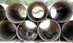 Sheltering from the heat in unused water pipes in Delhi