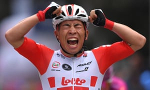 Caleb Ewan celebrates after winning a stage at the Giro
