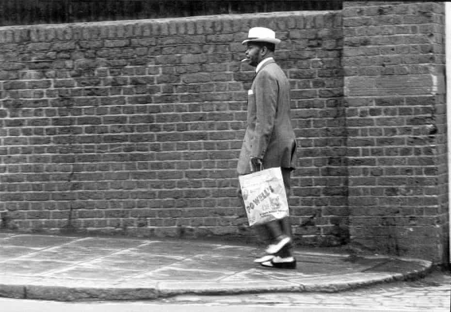 A man dressed in a zoot suit on Great Western Road, Notting Hill, London, 1968.