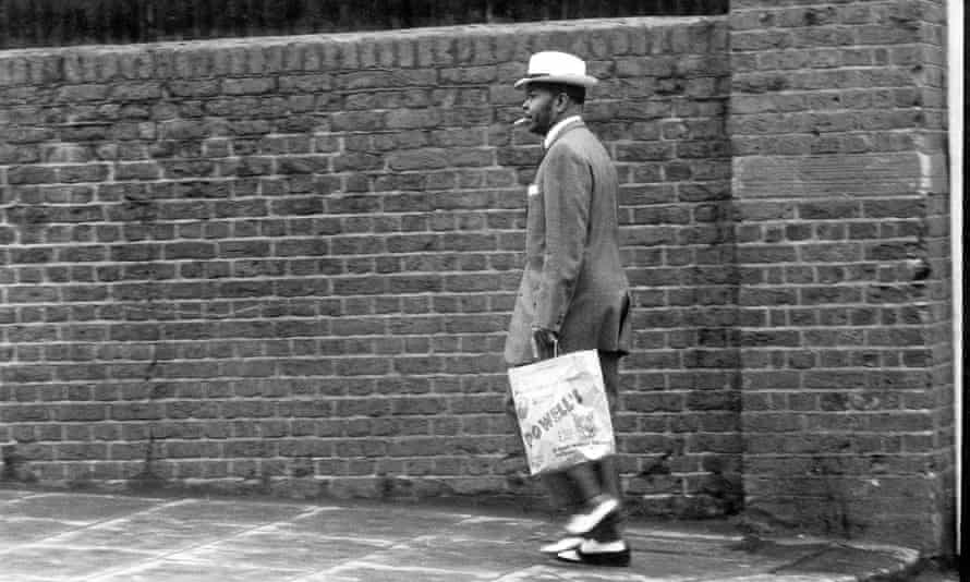 A man fashionably dressed in a zoot suit - wide legs and high waist - in Notting Hill, London, 1968.